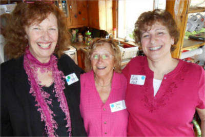 Val Brooks, Carol Cole, and Luca Har catch up at 2013 Founders Day.